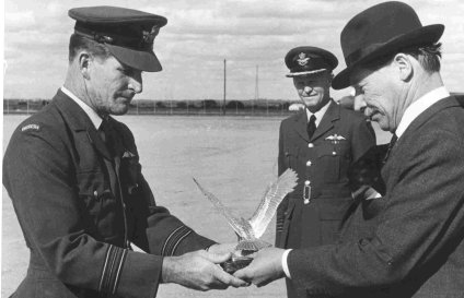 Sqn Ldr Norman Walsh receives the Jacklin Trophy