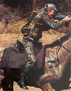 Neville, shooting from the saddle